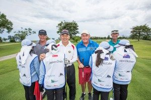 Centara World Masters Participants and their caddies wearing customized caddie bibs.